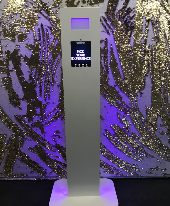 selfie pod with white & gold backdrop